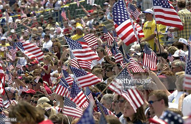 Supporters wave U.S. Flags as they attend the Rally for America event at Marshall University stadium May 24, 2003 in Huntington, West Virginia. The...