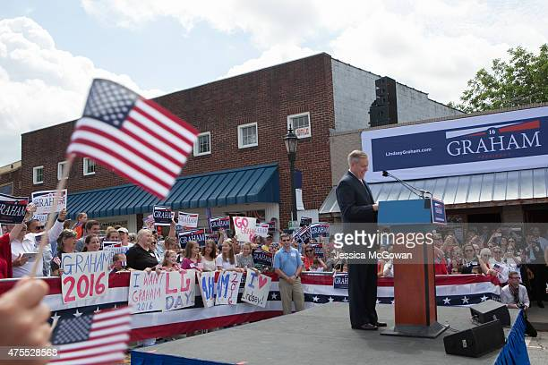 Supporters waves signs and flags for US Sen Lindsey Graham as he announces his candidacy for United States President during an outdoor event on June...