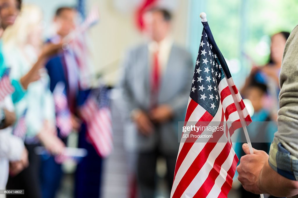 Supporters waving American flags at political campaign rally : Stock Photo