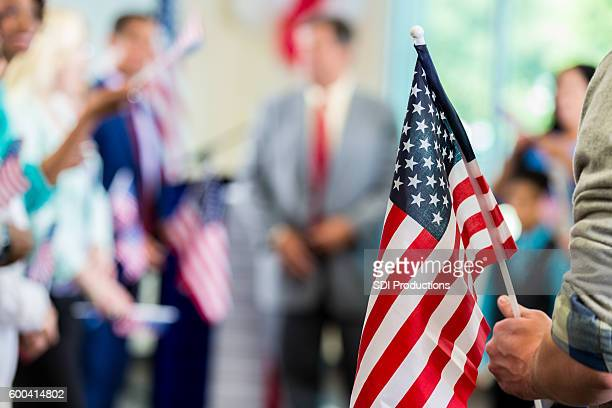Supporters waving American flags at political campaign rally