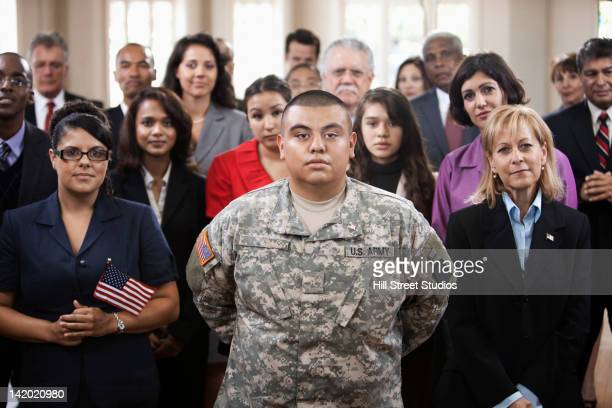 supporters waving american flags at political gathering - hero and not superhero stock pictures, royalty-free photos & images