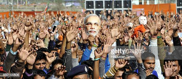 BJP supporters waving hands an election rally addressed by Prime Minister Narendra Modi at Raya on December 8 2014 in Jammu India Modi promised that...