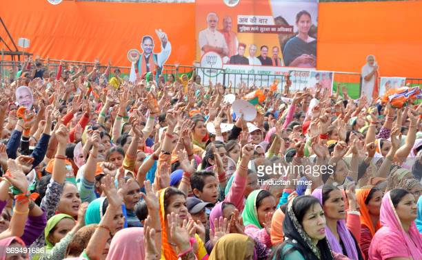 BJP supporters waving hands an election rally addressed by Prime Minister Narendra Modi at Rehan in Fatepur assembly segment on November 2 2017 in...