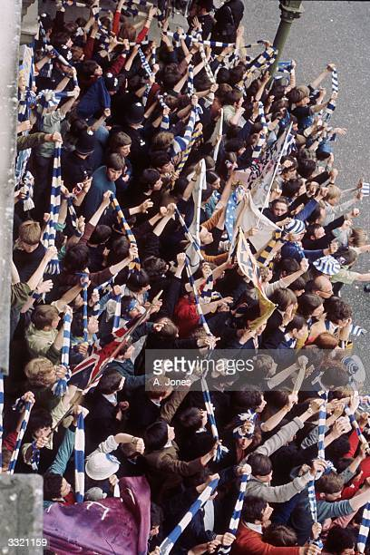 Supporters waving scarves and banners at Chelsea FC's victory parade to celebrate their winning the European CupWinners' Cup