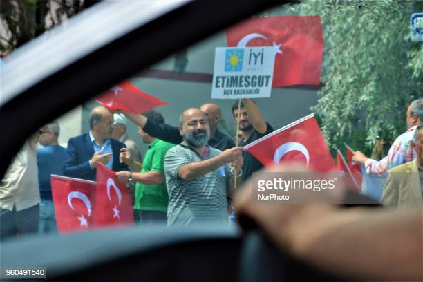 Supporters waving Turkish flags are seen through the front window of a car during a rally in support of Meral Aksener presidential candidate and the...