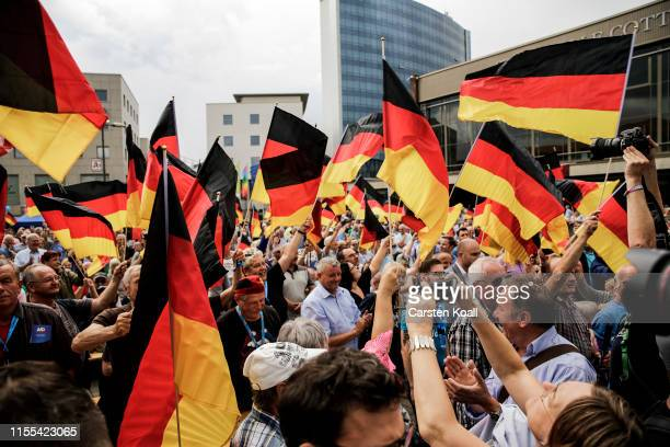 Supporters waviong flags during the inaugural AfD election rally in Brandenburg state elections on July 13 2019 in Cottbus Germany Both Brandenburg...