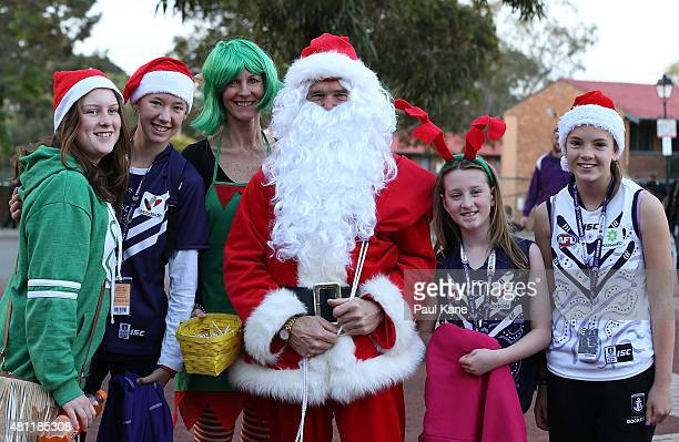 Supporters wear festive hats and pose with Santa to celebrate Christmas in July before the round 16 AFL match between the Fremantle Dockers and the...
