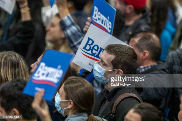 Supporters wear medical masks as fears of coronavirus increase in California during a campaign rally for Presidential candidate Sen Bernie Sanders at...