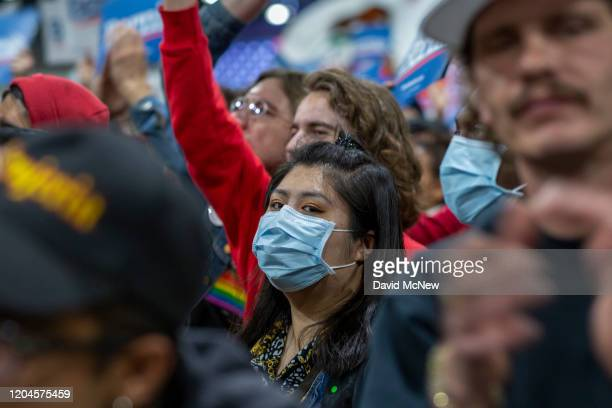 Supporters wear medical masks, as fears of coronavirus increase in California, during a campaign rally for Presidential candidate Sen. Bernie Sanders...