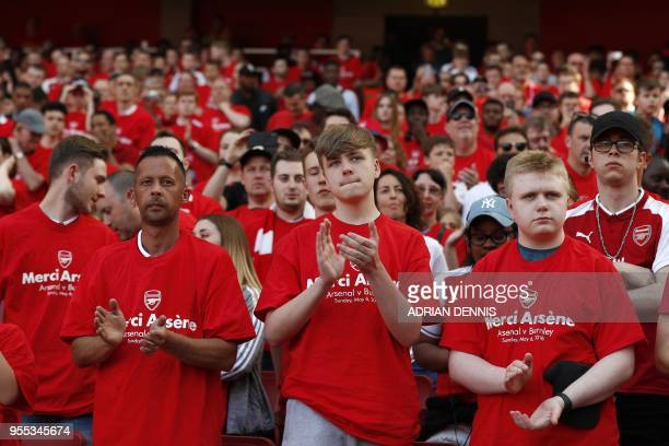 """Supporters wearing """"merci Arsene"""" T-shirts applaud their departing manager before the English Premier League football match between Arsenal and..."""