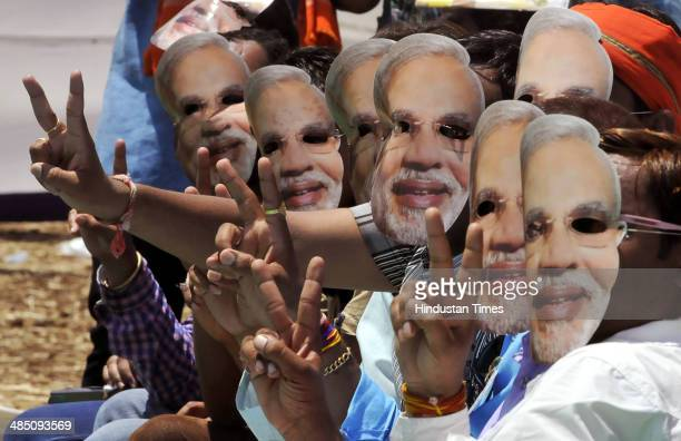 Supporters wearing Modi mask attending an election rally of BJP prime ministerial candidate Narendra Modi and Madhya Pradesh Chief Minister Shivraj...