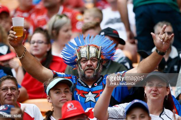 Supporters wearing superheroes costumes cheer for their team during the Vodacom Superhero Sunday rugby union match between the Vodacom Bulls and the...