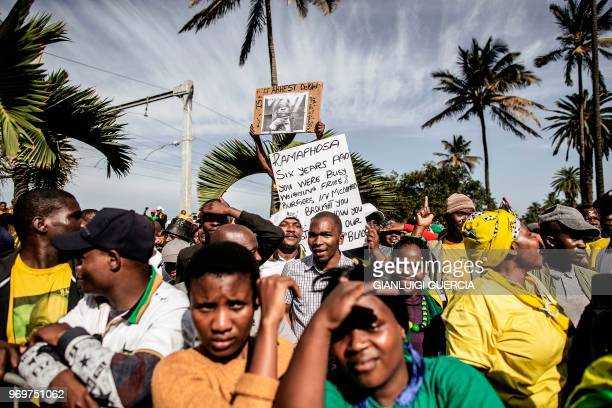 Supporters wearing the colours of the African National Congress sing and dance on June 8 2018 outside the High Court in Durban during a rally in...