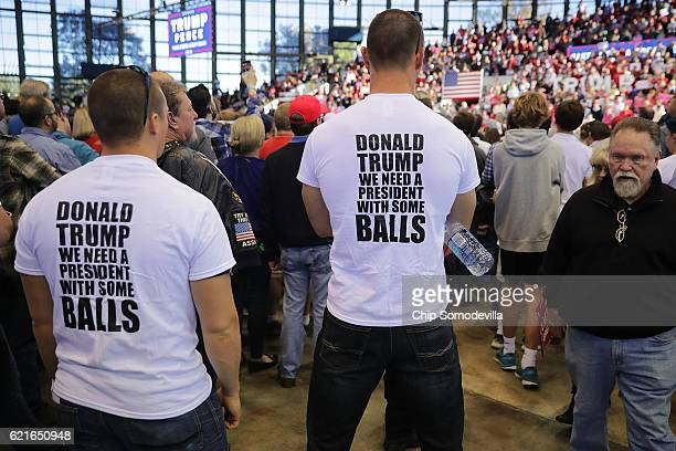 Supporters wearing Trump tshirts listen to Republican presidential nominee Donald Trump during a campaign rally at the JS Dorton Arena November 7...