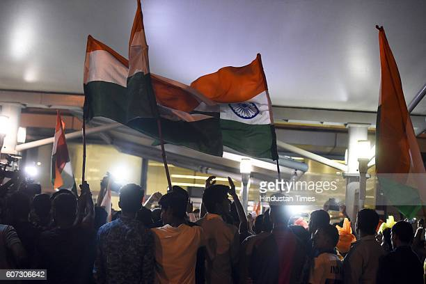 Supporters welcome Indian Paralympics athlete Deepa Malik on her arrival at Indira Gandhi International Airport on September 17 2016 in New Delhi...