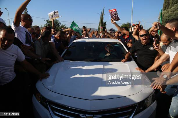 Supporters welcome the Palestinian resistance icon Raed Salah near his house after Israeli court ordered the conditional release of him in Haifa...