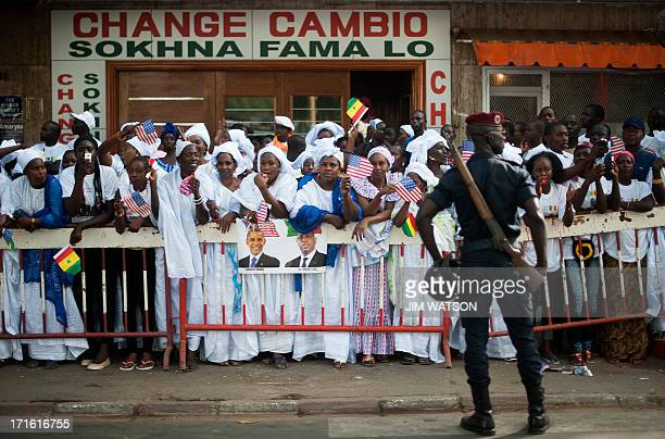 Supporters welcome US President Barack Obama to Senegal along his motorcade route in Dakar on June 27 2013 US President Barack Obama lavished praise...