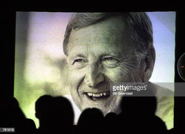 Supporters who have gathered at a democratic rally to watch election returns watch a tribute film to the late Missouri Governor Mel Carnahan November...