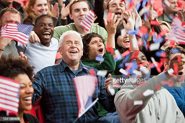 usa supporters with flags and ticker tape - patriotic stock pictures, royalty-free photos & images