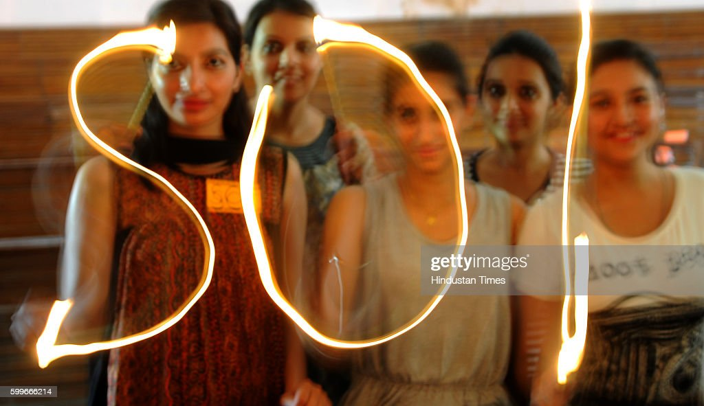 SOI supporters writing SOI with lighted candles ahead of students` union elections at Panjab University on September 6 2016 in Chandigarh India
