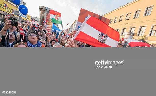 Supportersof Rightwing Austrian Freedom Party presidential candidate Norbert Hofer cheer during Hofer's final election campaign rally at the Viktor...