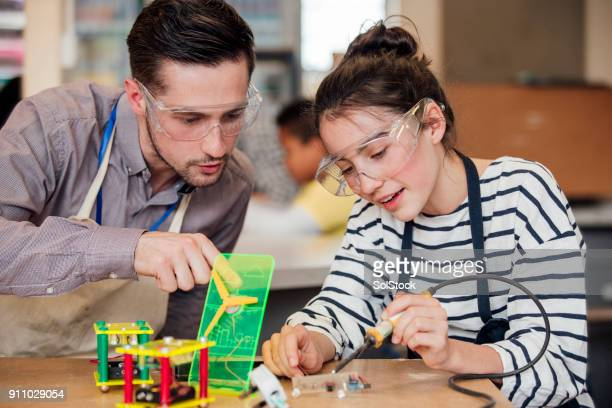 supporting a student - stem stock pictures, royalty-free photos & images