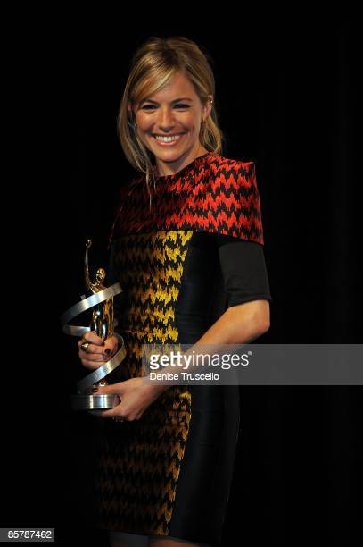 Supporting Actress of the Year Sienna Miller poses for photos in the press room at ShoWest 2009's Final Night Banquet And Award Ceremony on April 2...