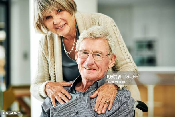 supporting each other through the grey years - fragility stock pictures, royalty-free photos & images