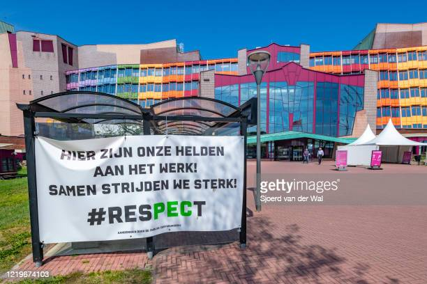 Supportive banner for the healthcare workers at the main entrance of Isala hospital on April 18 2020 in Zwolle Netherlands Instead of adopting a hard...