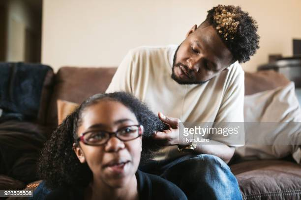 Supportive Father Helps Daughter Braid Hair