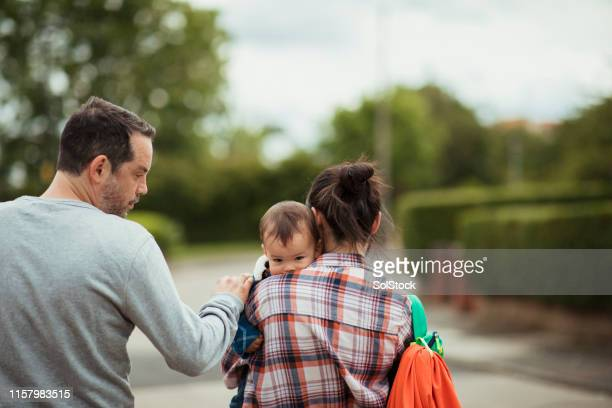 supportive parents caring for their tired son - baby boys stock pictures, royalty-free photos & images