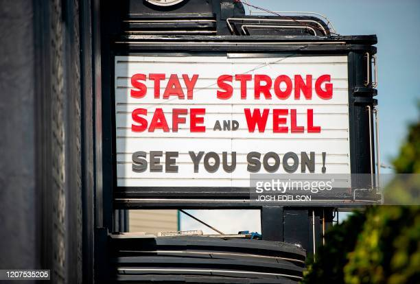 A supportive sign is posted on a theater's marquis in the North Beach area of San Francisco California on March 17 2020 Millions of San Francisco...