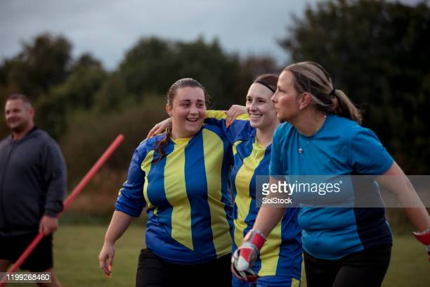 supportive teammates - football team stock pictures, royalty-free photos & images