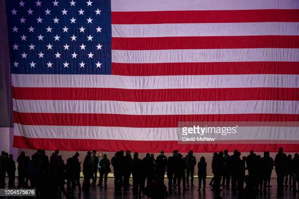 Supports are dwarfed by an American flag at a campaign rally for Presidential candidate Sen Bernie Sanders at the Los Angeles Convention Center on...