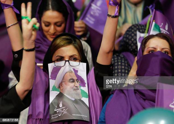 Supports of Iranian President and presidential candidate Hassan Rouhani attend a campaign rally in Tehran on May 9 2017 / AFP PHOTO / STR