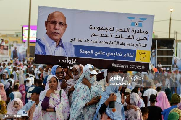 Supports of presidential candidate former Mauritanian general Mohamed Ould Ghazouani one of six candidates running in the presidential race gather...