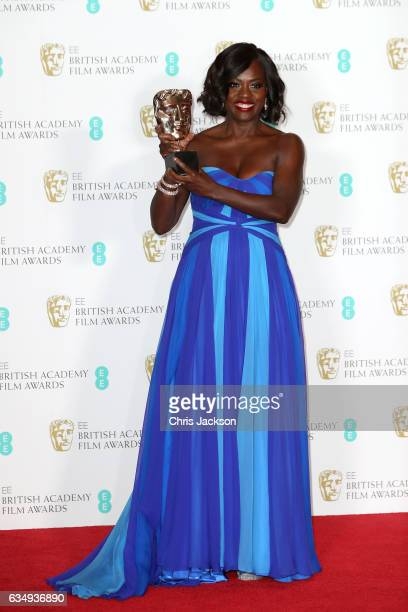 Suppoting Actress winner Viola Davis poses with her award in the winners room during the 70th EE British Academy Film Awards at Royal Albert Hall on...