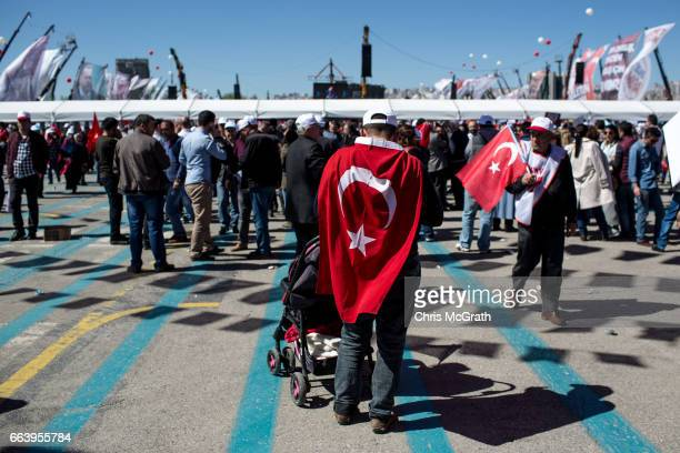 A 'EVET' supprter waits to enter a rally hosted by Turkish President Recep Tayyip Erdogan on April 2 2017 in Ankara Turkey The capital Ankara is the...