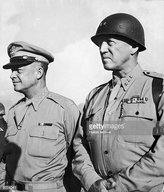 Supreme Allied Commander General Dwight Eisenhower and General George Patton standing at attention next to each other, circa 1944.