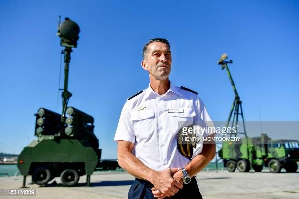 Supreme Commander of the Swedish Armed Forces Micael Bydén stands in front of a search radar system and other military equipment in Visby Sweden on...