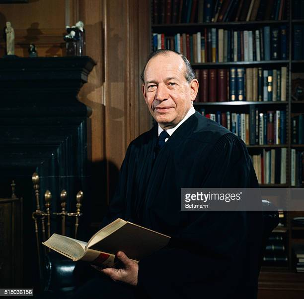 Supreme Court Associate Justice Abe Fortas wearing his robes in his office.