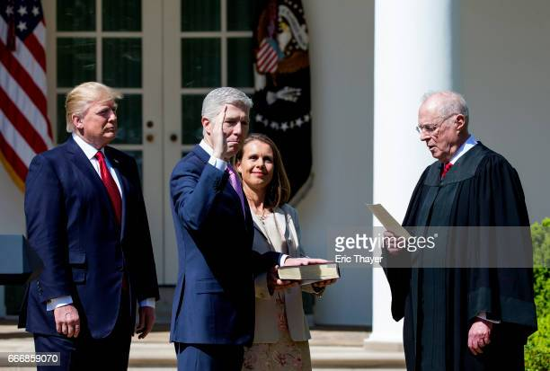 S Supreme Court Associate Justice Anthony Kennedy administers the judicial oath to Judge Neil Gorsuch as President Donald Trump looks on during a...