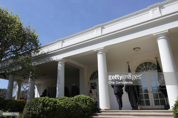 S Supreme Court Associate Justice Anthony Kennedy and President Donald Trump walk back inside the White House after Associate Justice Neil Gorsuch...
