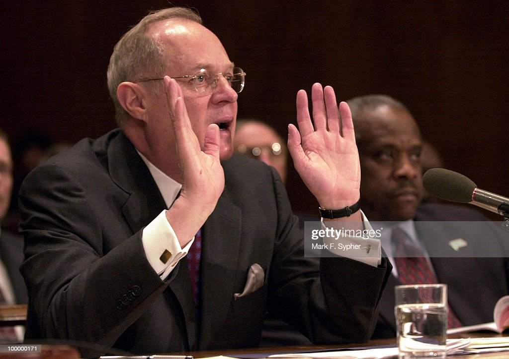 Supreme Court Associate Justice Anthony Kennedy describes to Sen. Ernest F. Hollings (R-NC) the Supreme Courts proposed budget, during a Commerce, Justice, State and the Judiciary Subcommittee Hearing on Tuesday morning. To Kennedy's left is Supreme Court Associate Justice Clarence Thomas.
