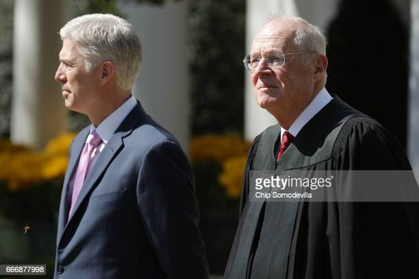 S Supreme Court Associate Justice Anthony Kennedy prepares to administer the judicial oath to Judge Neil Gorsuch during a ceremony in the Rose Garden...