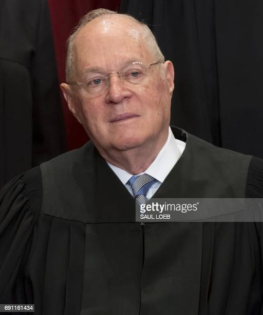 US Supreme Court Associate Justice Anthony M Kennedy sits for an official photo with other members of the US Supreme Court in the Supreme Court in...