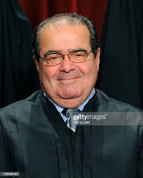 US Supreme Court Associate Justice Antonin Scalia participates in the courts official photo session on October 8 2010 at the Supreme Court in...