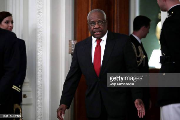 Supreme Court Associate Justice Clarence Thomas arrives for the ceremonial swearing in of Associate Justice Brett Kavanaugh in the East Room of the...