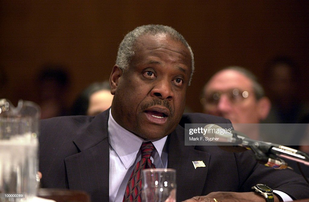 Supreme Court Associate Justice Clarence Thomas describes to Sen. Ernest F. Hollings (R-NC) the Supreme Courts proposed budget, during a Commerce, Justice, State and the Judiciary Subcommittee Hearing on Tuesday morning.