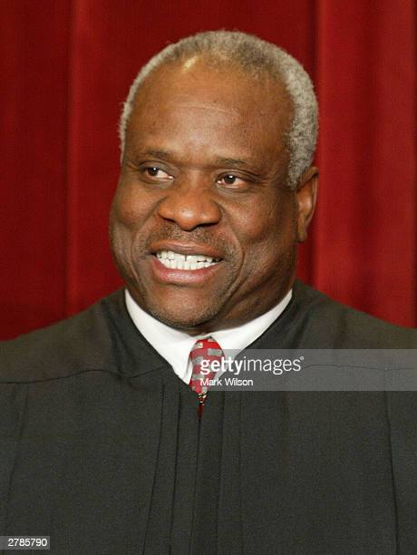 Supreme Court Associate Justice Clarence Thomas poses for a picture at the US Supreme Court December 5, 2003 in Washington, DC.